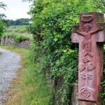 A wayside cross by a vineyard near Rüdesheim am Rhein, Hesse, symbolizing the protection of Jesus over the produce of the land.