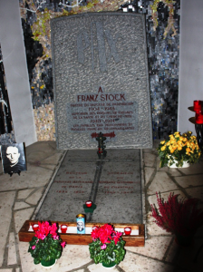 Stock's shrine and grave at St. Jean-Baptiste Rechèvres Church, in Chartres. The inscription on the headstone reads:  To Franz Stock Priest of the diocese of Paderborn 1904-1948 Chaplain of the prisons of Fresnes La Santé and Cherche-Midi 1940-1944 The families of the French prisoners and executed are appreciative The inscription on the ground reads on the left: Rector of the German parish of Paris 1934-1944; on the right: Superior of the barbed-wire seminary of Chartres 1945-1947 Source: Lauren N. Faulkner; used with permission.
