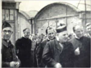 "The religious figures involved in getting the ""barbed wire seminary"" off the ground. From left to right: Georges Le Meur; Wilhelm Delbeck, Stock's main assistant at the seminary; Jean Rodhain (?); Angelo Roncalli, Vatican nuncio to France; Franz Stock. Source: H. Briand and Les Amis de Franz Stock; used with permission."