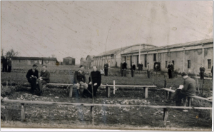 Taking in the air outside the barracks. Franz Stock is the priest seated in the middle of the picture. Source: H. Briand and Les Amis de Franz Stock; used with permission.
